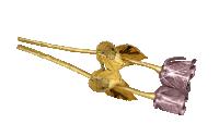 Prawdziwa róża zatopiona w czystym złocie. Cenny kruszec w dwóch odcieniach: żółtym i różowym.