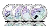Srebrne monety amerykańskie z hologramem.