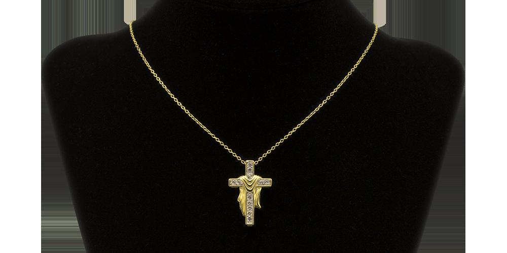Srebrny krzyżyk selektywnie uszlachetniony złotem.